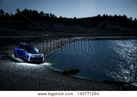 Saratov, Russia - September 28, 2015: Car Subaru Forester stand at countryside off-road at night