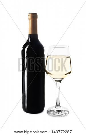 Glass of white wine and bottle isolated on white