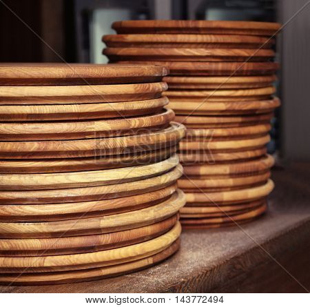 Pile of round wooden boards for pizza