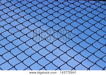Fence and sky - refugee crisis concept