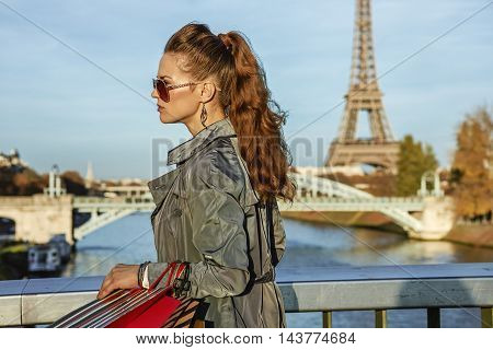 Young Elegant Woman With Shopping Bags In Paris, France Walking