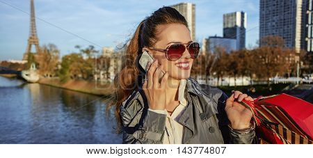 Elegant Woman With Shopping Bags Speaking On Mobile In Paris
