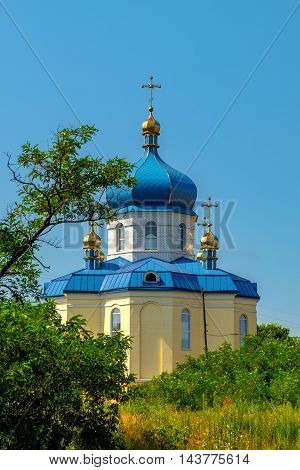 Rural Christian Church with blue domes in Ukraine