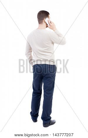 back view of standing young man with tablet computer in the hands of. Rear view people collection.  backside view of person.  Isolated over white background. The bearded man in a white sweater warm