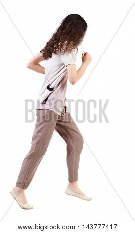 side view of running  woman. beautiful girl in motion. backside view of person.  Rear view people collection. Isolated over white background. Long-haired curly girl runs past the camera.