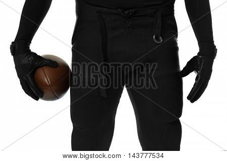 Hands of american football player holding ball on white background