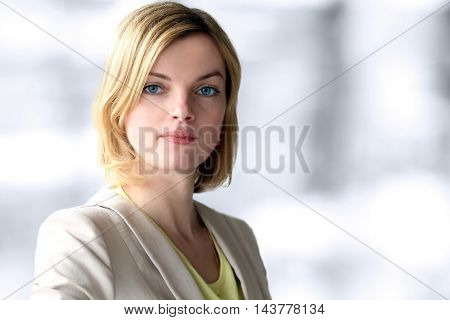 The Beautiful smiling business woman portrait. Gray background behind