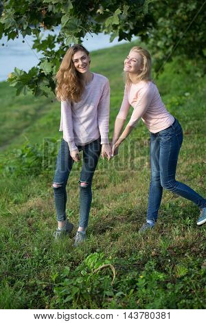 Two Young Girls Hold Hands
