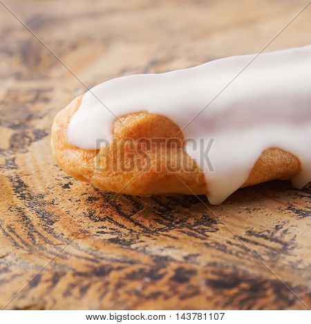 Traditional French Cuisine. Eclair Drizzled With White Icing. Br