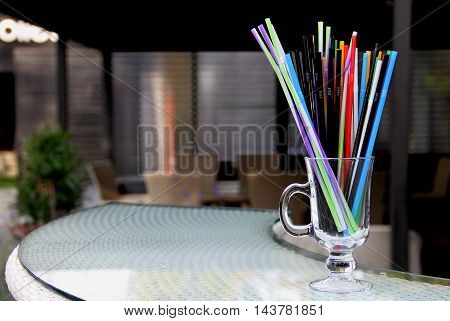 Colorful drinking straws in glass on the bar at the resting area