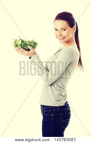 Woman eating lettuce.