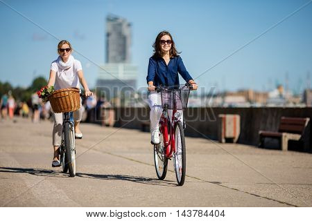 Healthy lifestyle - people riding bicycles in city
