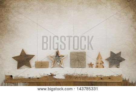Old handmade christmas decoration with presents on white and brown vintage background.