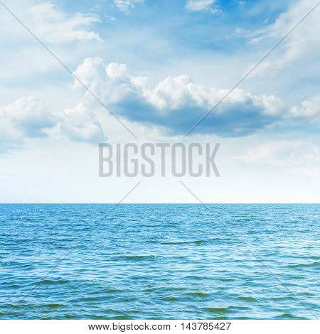 blue sea to horizon and clouds over it