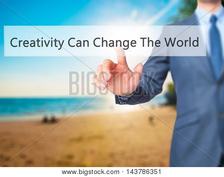 Creativity Can Change The World -  Businessman Press On Digital Screen.