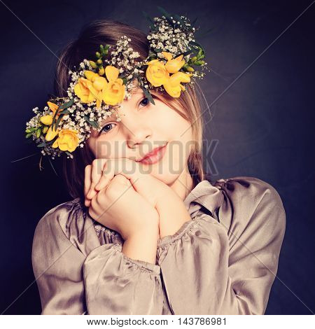 Cute Little Girl with Yellow Flowers. Child on Background