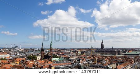 Copenhagen, Denmark - August 15, 2016: Panoramic view over the city from the bell tower of Vor Frue Cathedral