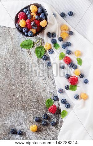 Ripe Berries. White, Red Raspberries And Blueberries In Brown Cu