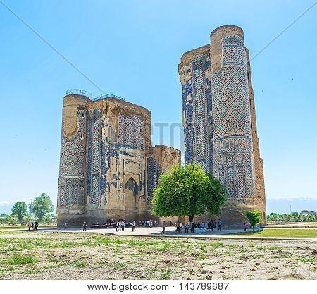 SHAKHRISABZ UZBEKISTAN - MAY 2 2015: One of the main landmarks of old Shakhrisabz is the ruins of Ak-Saray Palace on May 2 in Shakhrisabz.