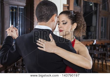 Tango Dancer Closing Eyes While Performing Gentle Embrace With M