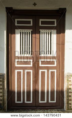 Photo of the Old wooden retro double front door. Security, protection concept