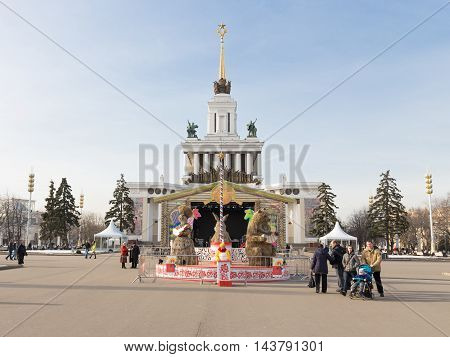 Moscow - March 11 2016: Festival - Carnival at the Exhibition Center and people walk and look at the traditional figure of straw March 11 2016 Moscow Russia