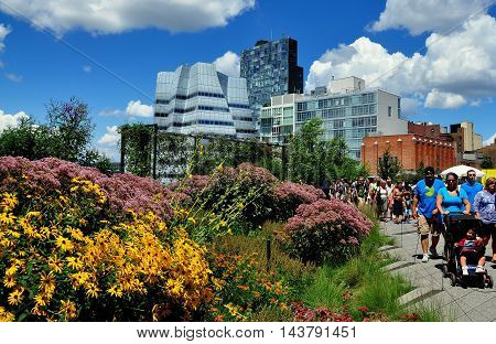 New York City - August 3 2013 People strolling along the High Line Park built on a historic elevated freight train rail line on the West Side of Manhattan