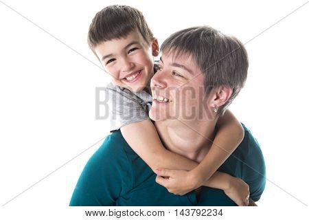 A nice young little son embracing his mother