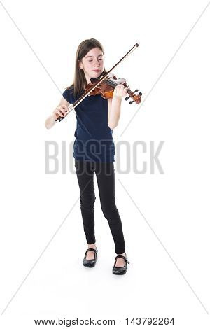 A girl with long hair playing on violin