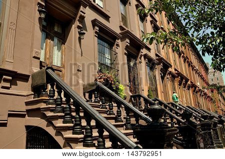 New York City - August 24 2009: Early 20th century brownstones with high stoops on Manhattan Avenue at West 121st Street in Harlem