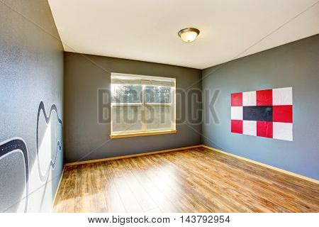 Empty Kids Room Interior With Grey Walls  And Hardwood Floor.