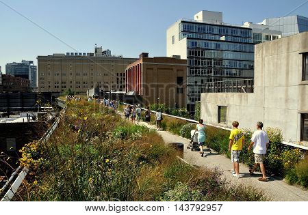 New York City - August 19 2011: People strolling along the High Line Park built atop a former elevated freight railroad line running from West 12th to 34th Streets in Manhattan
