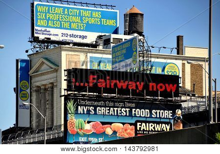 New York City - August 29 2011: Advertising signs cover a storage warehouse on West 130th Street in upper Manhattan (DT EXCL)