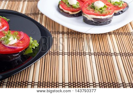 Vegetable Dishes Of Stewed Eggplant And Fresh Tomato Closeup