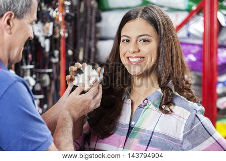 Female Customer Buying Guinea Pig From Salesman