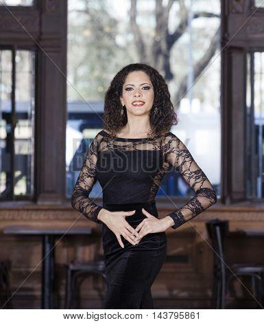 Beautiful Young Woman Performing Tango In Restaurant