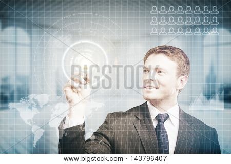 Happy young businessman pressing virtual buttons on digital interface with abstract map. Blurry interior background