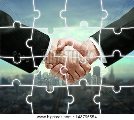 Businessmen shaking hands on city background with puzzle piece pattern. Teamwork concept