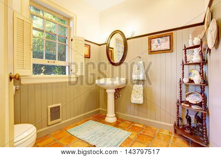 Bathroom Interior With Antique Wooden Shelf And Tile Floor.