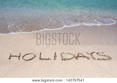 Word Holidays Sketched On A Tropical Beach