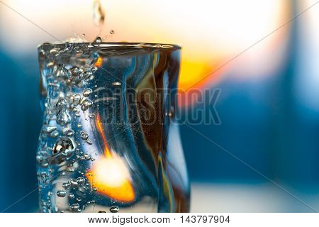 Misted Glass With Cold Alcohol Drink Or Water On The Beach Bar And Vibrant Sunset