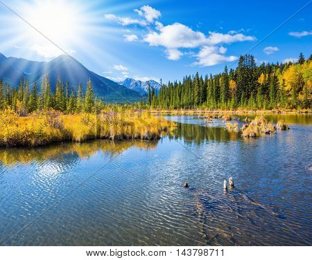 Concept of active tourism and ecotourism. Gorgeous sunset on the Vermilion Lakes in mountains of Banff National Park. Rocky Mountains, Canada