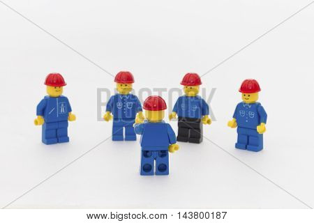 Orvieto, Italy - December 10th 2014: Lego mini figure workman at work on white background. Lego is a popular line of construction toys manufactured by the Lego Group