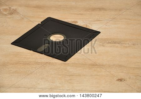 A stiffy disc on a wooden background