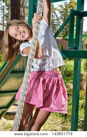 Girl riding on a swing at the playground