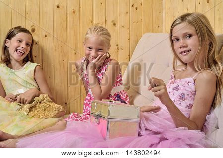 girl playing at home on the couch with toys