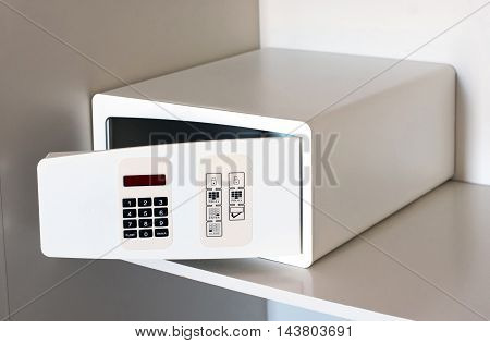 Open empty electronic hotel safe on a shelf for safekeeping of valuables while travelling