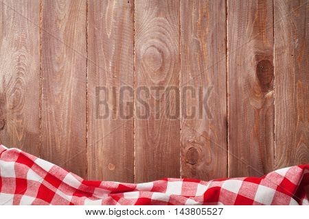 Towel over wooden kitchen cooking table. Top view with copy space