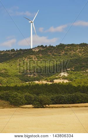 Wind turbines in a forest. Clean alternative renewable energy. Vertical