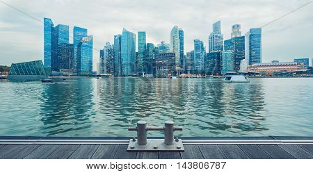Singapore central quay panorama with wooden decks on foreground